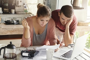 Young couple reviewing finances