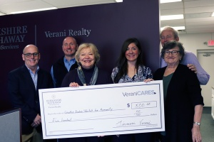 Verani agents holding big check