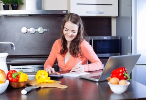 woman in kitchen chopping vegetables