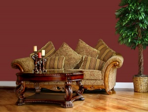 Brown couch in living room with red walls