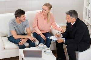 realtor talking to couple