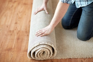person installing carpet