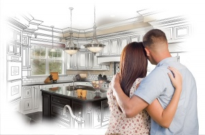 young couple looking at kitchen