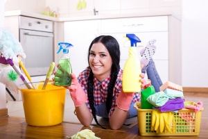 woman holding different cleaners