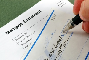 writing check for mortgage payment