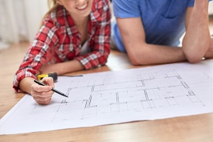 couple reviewing blueprints