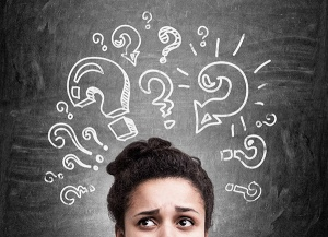 Woman with confused look and question marks around head