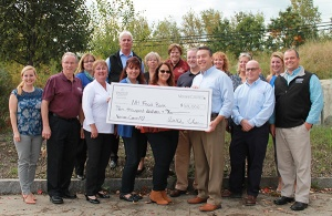 Group of Verani agents presenting check to New Hampshire Food Bank