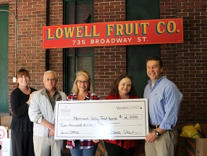 Verani agents present Merrimack Valley Food Bank with a donation